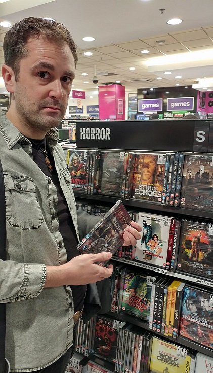 Nathan Head holding a Toymaker DVD in HMV Birmingham