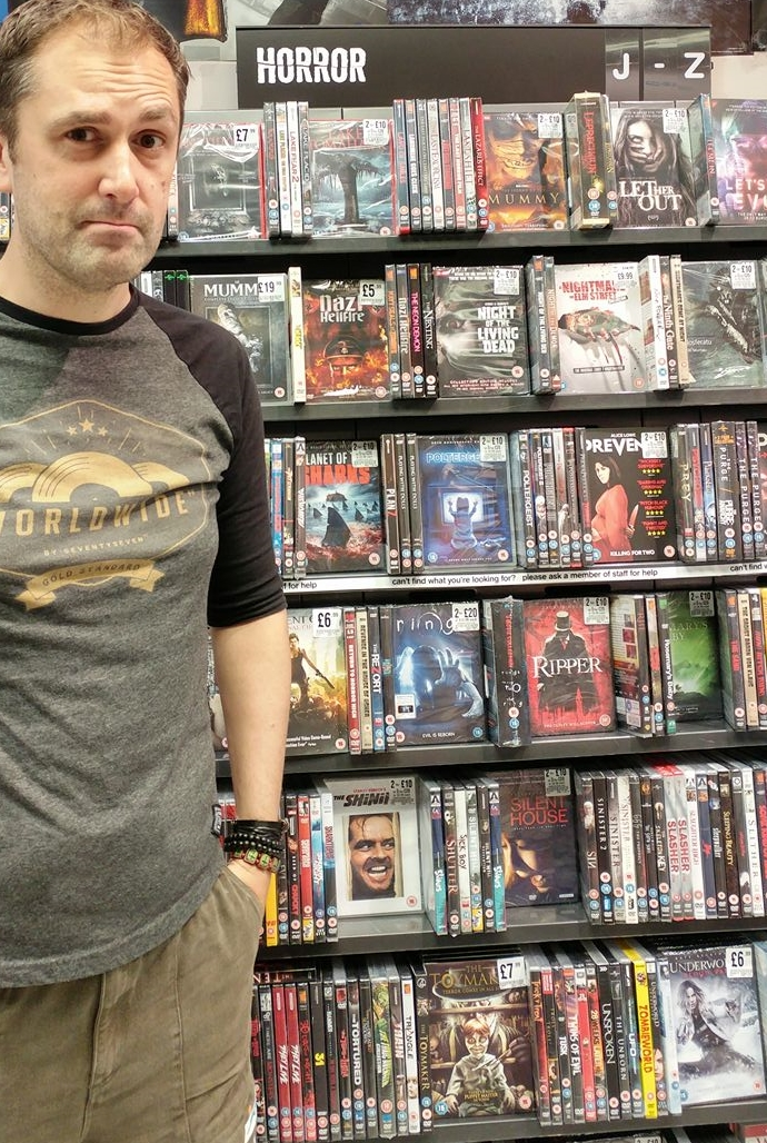 Nathan Head standing by The Toymaker DVD in HMV Chester