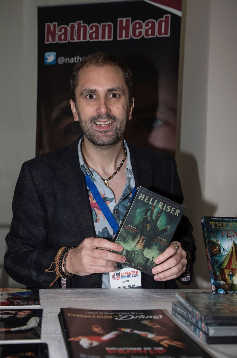 actor Nathan Head signing copies of Hellriser at Chester Comic Con 2018