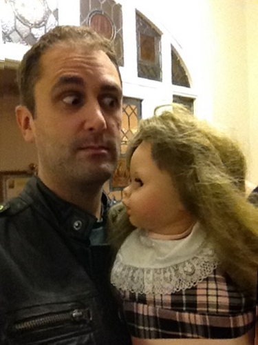 Actor Nathan Head with the crying Isabelle doll on the set of The Toymaker
